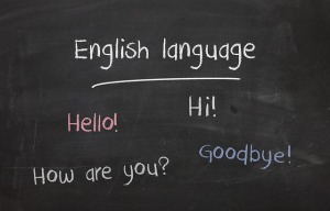 Chalkboard. Text reads: English language. Hello! Hi! How are you? Goodbye!